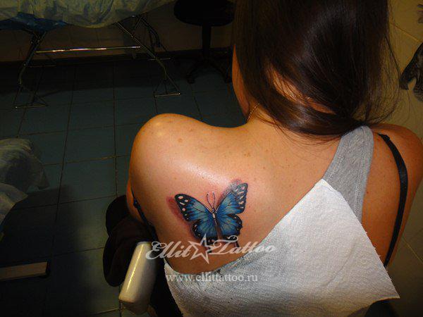 Тату две бабочки с цветочком в стиле акварель из категории бабочки